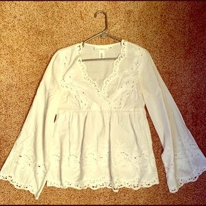 white blouse with flared sleeves.